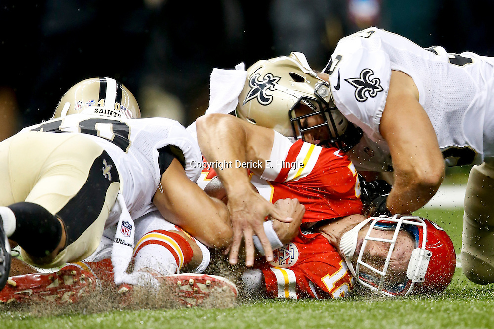 Aug 9, 2013; New Orleans, LA, USA; New Orleans Saints defensive back Chris Carr (40) and free safety Jim Leonhard (36) combine to tackle Kansas City Chiefs quarterback Ricky Stanzi (12) during the second half of a preseason game at the Mercedes-Benz Superdome. Mandatory Credit: Derick E. Hingle-USA TODAY Sports