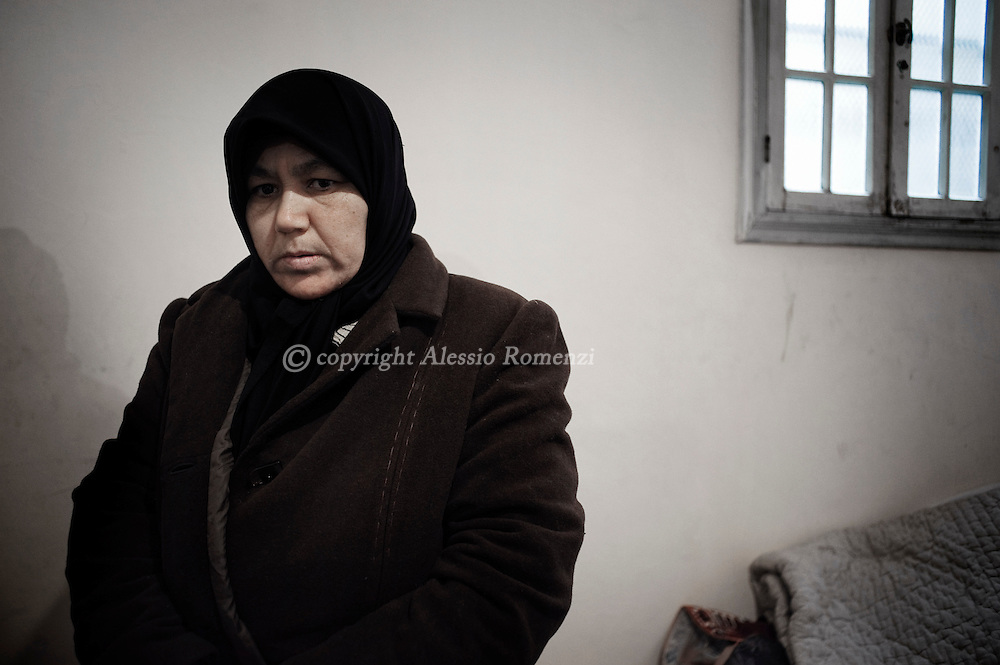SYRIA, HOMS, Baba Amro: A Syrian woman is seen in her house in Baba Amro, southern neighborhood of Homs, as Al Assad Army is shelling that area on February 06, 2012.  ALESSIO ROMENZI