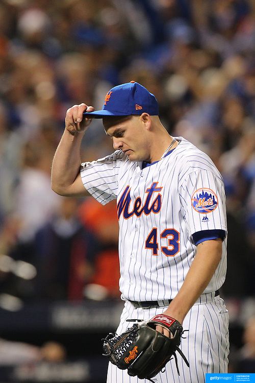 NEW YORK, NEW YORK - October 5: Pitcher Addison Reed #43 of the New York Mets tips his cap after pitching the eighth inning during the San Francisco Giants Vs New York Mets National League Wild Card game at Citi Field on October 5, 2016 in New York City. (Photo by Tim Clayton/Corbis via Getty Images)