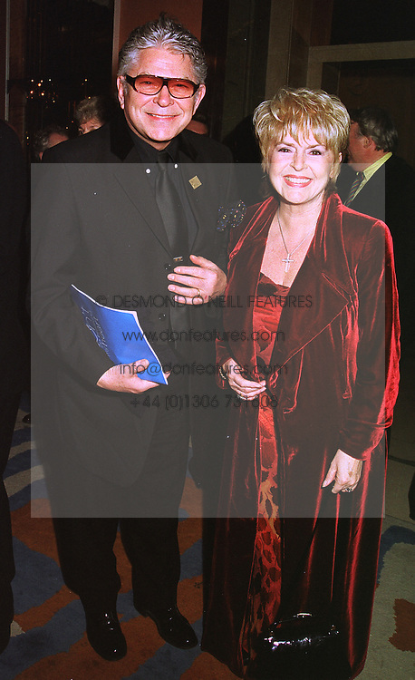 TV presenter GLORIA HUNNIFORD and her husband STEPHEN WAY, at a party in London on 4th February 1999.MOB 13