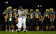 11 SEPT. 2009 -- ST. LOUIS -- An official resets the football for the Lindbergh High School offense following a penalty during the Flyers game against Oakville Friday, Sept. 11, 2009. Lindbergh led Oakville 14-0 at halftime on a pair of touchdowns by running back Eric Schwartz. Photo © copyright 2009 by Sid Hastings.