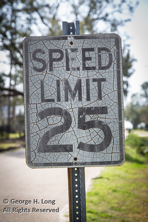 cracked 25 mile per hour speed limit sign