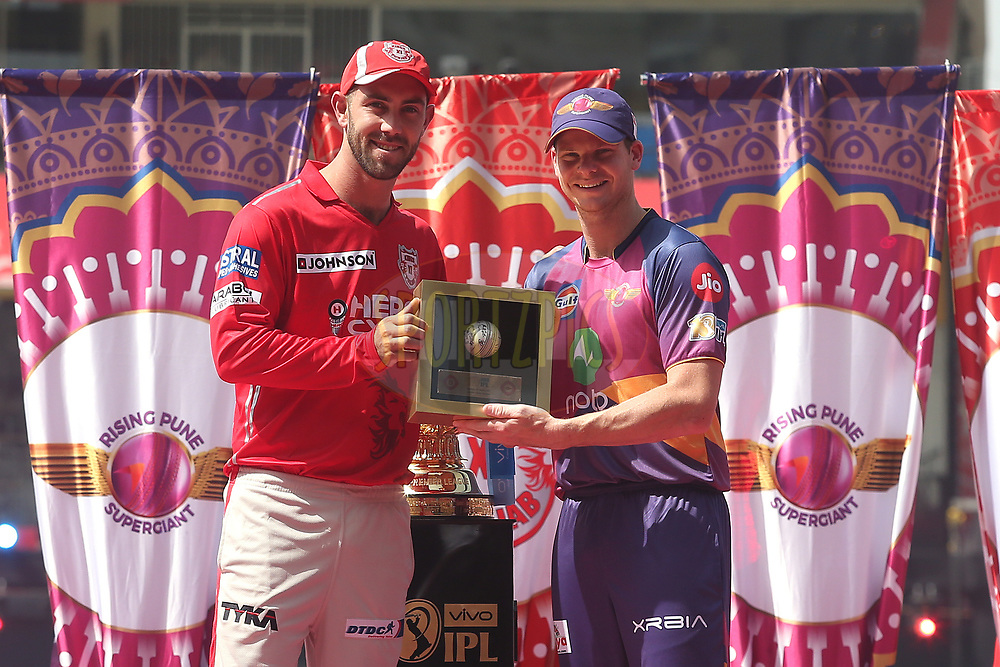 Kings XI Punjab captain Glenn Maxwell hands over the signed Spirit of Cricket ball to Rising Pune Supergiant captain Steven Smith during match 4 of the Vivo 2017 Indian Premier League between the Kings XI Punjab and the Rising Pune Supergiant held at the Holkar Cricket Stadium in Indore, India on the 8th April 2017<br /> <br /> Photo by Shaun Roy - IPL - Sportzpics