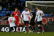 Bolton Wanderers forward Gary Madine argues with the referee after suffering a cut head during the Sky Bet Championship match between Bolton Wanderers and Milton Keynes Dons at the Macron Stadium, Bolton, England on 23 January 2016. Photo by Simon Davies.