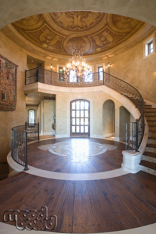 Circular entrance hallway and staircase with handrail Palm Springs