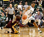 CMU junior Oliver Mbaigoto (25) and WSU sophomore Matt Vest (24) as the Central Michigan Chippewas play the Wright State University Raiders at the Nutter Center, Thursday, December 22, 2011.