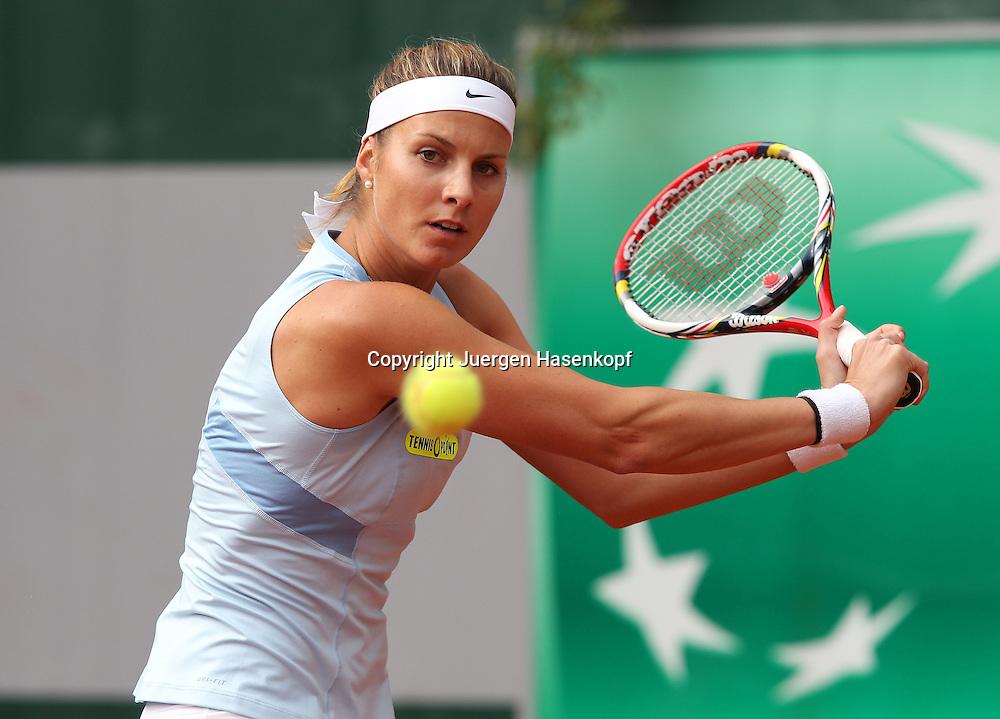 French Open 2013, Roland Garros,Paris,ITF Grand Slam Tennis Tournament,Mandy Minella (LUX),Aktion, Einzelbild,Halbkoerper,.Querformat,