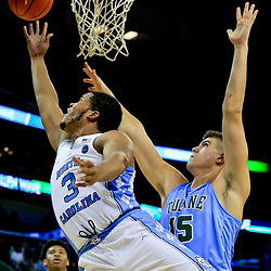 Nov 11, 2016; New Orleans, LA, USA;  North Carolina Tar Heels forward Kennedy Meeks (3) shoots over Tulane Green Wave center Ryan Smith (15) during the second half of a game at the Smoothie King Center. North Carolina defeated Tulane 95-75. Mandatory Credit: Derick E. Hingle-USA TODAY Sports