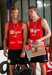 Jernej Potocnik and Danijel Koncilja during medal ceremony after the final matches of Slovenian National Championship in beach volleyball Kranj 2012, on June 30, 2012 in Kranj, Slovenia. (Photo by Vid Ponikvar / Sportida.com)
