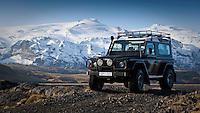 A Land Rover Defender by river Markarfljot. In background is Husadalur in Thorsmork and Eyjafjallajokull Glacier.<br /> <br /> Land Rover Defender við Markarfljót, Húsadalur og Eyjafjallajökull í baksýn.