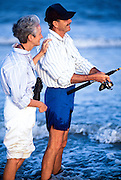 Senior couple spending time together surf fishing, Outer Banks, North Carolina, NC