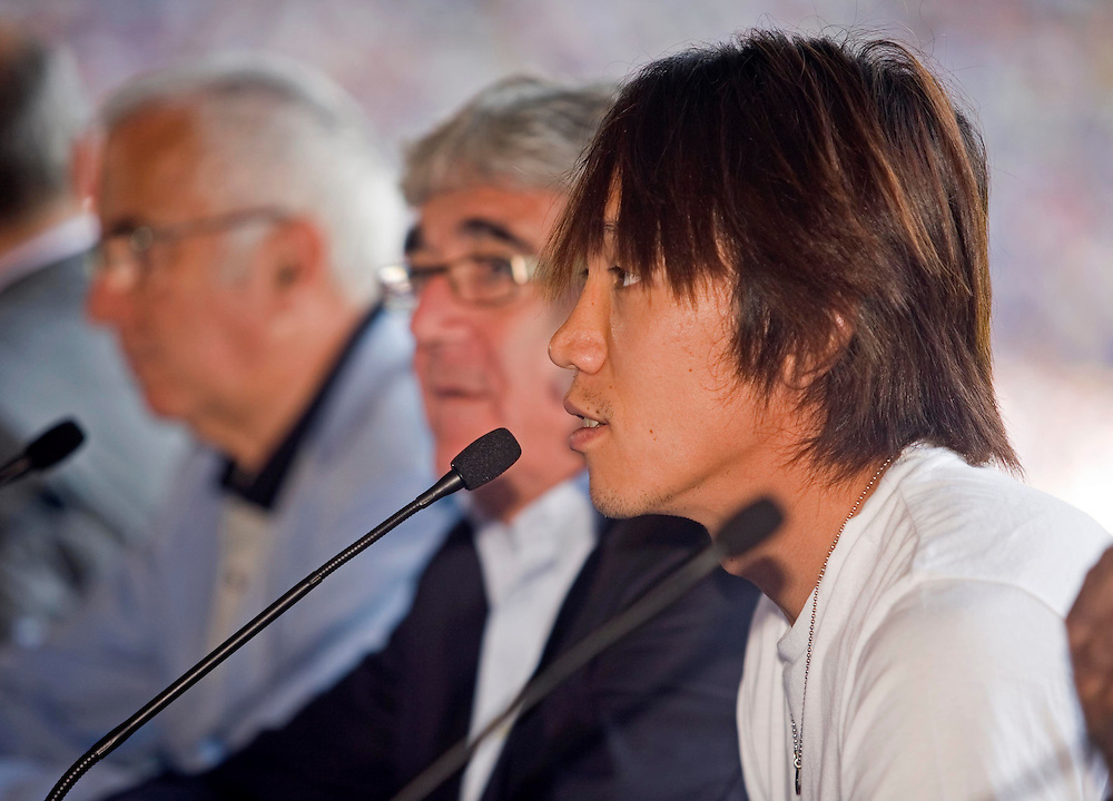"July 13th. 2009. Official presentation of Shunsuke Nakamura as a  new player of the R.C.D. Espanyol of Barcelona. More than seven thousand supporters and numerous mass media have been present  in the presentation of the new player of the team of first Spanish division league  ""La Liga"".In the image the president of R.C. D. Espanyol, Mr. Daniel Sanchez Llibre, on the right side of the Japanese player."