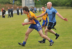 Knockmore's Andrew Keane and Westport's Stephen Broderick during the senior championship match.<br /> Pic Conor McKeown