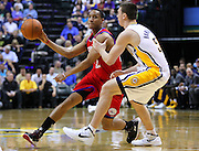 March 14, 2012; Indianapolis, IN, USA; Philadelphia 76ers shooting guard Evan Turner (12) passes the ball off as he is guarded by Indiana Pacers power forward Tyler Hansbrough (50) at Bankers Life Fieldhouse. Indiana defeated Philadelphia 111-94. Mandatory credit: Michael Hickey-US PRESSWIRE