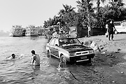 Drivers washing their Taxi and having a break by the Nile river, Cairo, Egypt 2008