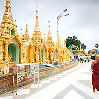 Elderly monk walking at shwedagon pagoda