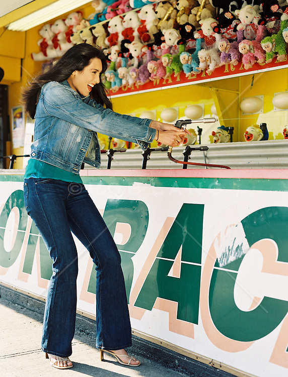 woman enjoying a game at a carnival