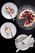 Serving cake with mascarpone and red fruits, top view shot.