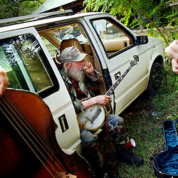 Along with fellow musicians, Ruth Huffman (left, on bass), and Burr Datz (right, on guitar), Rooster Ruley (center) takes a break from playing banjo during an impromptu jam after a life celebration memorial for Seeger held at the Limekiln Theater in Rockbridge County, Virginia on Sunday afternoon.