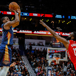 Jan 26, 2018; New Orleans, LA, USA; New Orleans Pelicans forward Darius Miller (21) shoots a three pointer over Houston Rockets guard James Harden (13) during the fourth quarter at the Smoothie King Center. Pelicans defeated the Rockets 115-113. Mandatory Credit: Derick E. Hingle-USA TODAY Sports