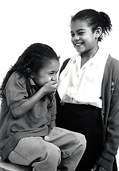 Studio portrait of two girls UK 1990s