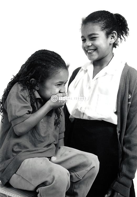 Studio portrait of two girls UK 1990s