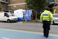 © Licensed to London News Pictures. 02/06/2018. London, UK.  Police and forensic tent at the crime scene cordon in Cable Street, east London this morning. Police were called to Cable Street E1 at 17:56 on Friday 1st June to reports of a stabbing. A 22 year old male suffering from multiple stab wounds was taken to an east London hospital in a critical condition. The victim remains in a critical condition this morning.  Photo credit: Vickie Flores/LNP