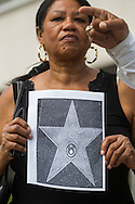 Maria Ceballos holds a picture with a star of Bill Cosby during a news conference on July 9, 2015 in Los Angeles, California. A coalition of black civil-rights advocates calls onto the Hollywood Chamber of Commerce President Leron Gubler to remove Bill Cosby's star on the Hollywood Walk of Fame. (Photo by Ringo Chiu/PHOTOFORMULA.com)
