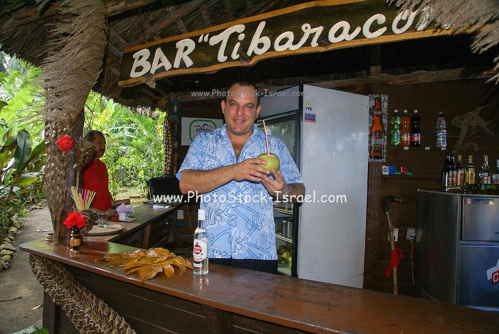 Cuba, Guantanamo, Local barman in a bar