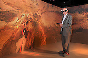 Michel Serres sur fond de Grottes de Lascaux, le 05 juin 2014, dans la salle 3D de Dassault Systemes, Velizy, France. Photo Manuel Cohen