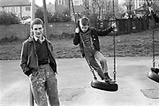 Neville and Ian on swings at Micklefield Park,High Wycombe. UK, 1980s.