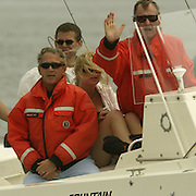 President Bush, left, father former President George H. W. Bush, and daughter Jenna Bush, center, cruise on the family boat during a fishing expedition Sunday, July 7, 2002, in Kennebunkport, Maine.  President Bush is spending the Independence Day weekend in Kennebunkport, Maine, home of his parents...Photo by Khue Bui