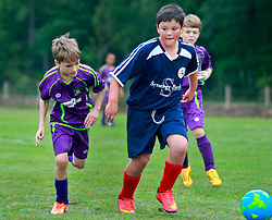 11 April 2015. Hammond, Louisiana.<br /> U9 New Orleans Jesters Elites, team purple play HTSA Bombers. Jesters emerge with a 10-1 victory in the first round of the Strawberry Cup hosted by the South Tangipahoa Youth Soccer Association (STYSA).<br /> Photo; Charlie Varley/varleypix.com
