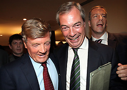 "© Licenced to London News Pictures. 26/05/2014. London. UK.  <br /> Nigel Farage, leader of the UK Independence Party (UKIP), is pictured celebrating his European Parliamentary success alongside party donor Paul Sykes at a press conference in London, May 26th 2014. The UKIP leader said his ""dream has become a reality"" and UKIP is now the ""third force"" in British politics after it topped the European polls.<br /> Photo Credit: Susannah Ireland"