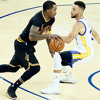04 June 2017: Cleveland Cavaliers guard JR Smith (5) drives past Golden State Warriors guard Stephen Curry (30) during the Golden State Warriors 132-113 victory over the Cleveland Cavaliers, in game 2 of the 2017 NBA Finals, at the Oracle Arena, Oakland, California, USA.