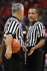 16 November 2014:  Referees Randy McCall and Verne Harris have a discussion at mid court during an NCAA non-conference game between the Utah State Aggies and the Illinois State Redbirds.  The Aggies win the competition 60-55 at Redbird Arena in Normal Illinois.
