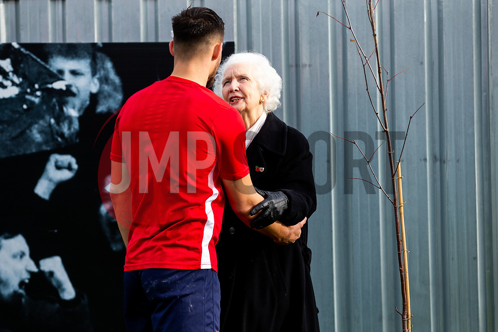 Marina Dolman greets Bailey Wright as Representatives of Bristol City take part in a ceremony to plant tree's in memory of the 7 Bristol City player's who lost their lives serving during WW1 - Rogan/JMP - 09/11/2018 - FOOTBALL - Failand Training Ground - Bristol, England.