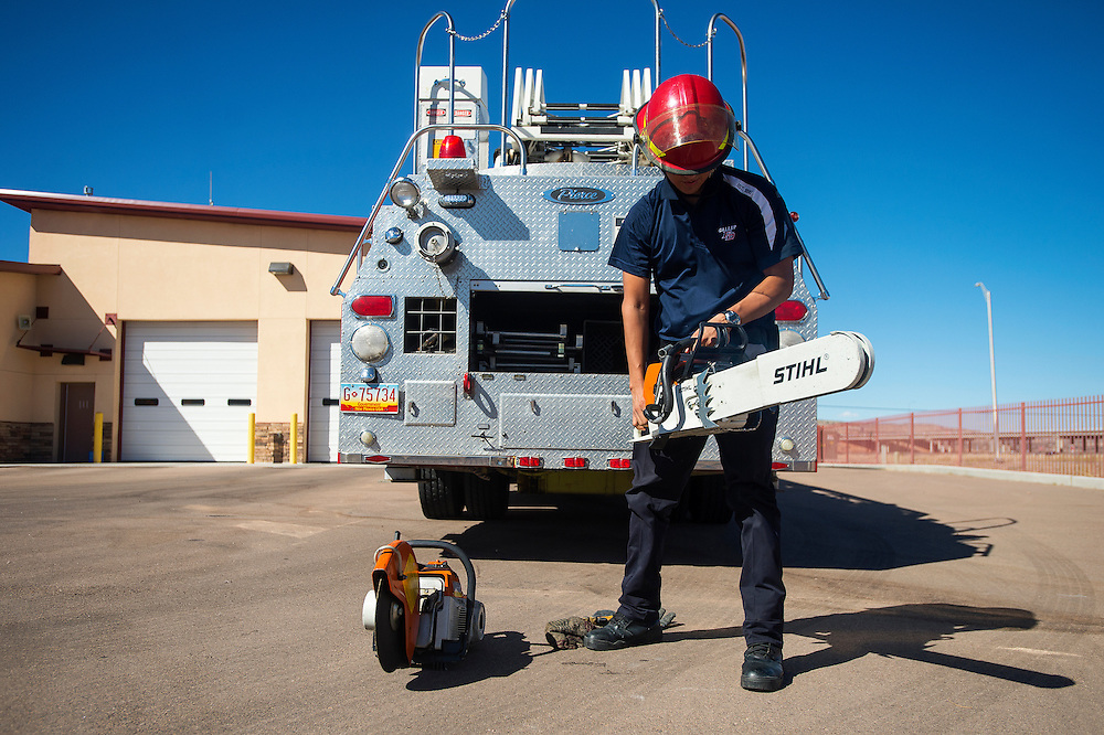 100813      Brian Leddy<br /> Gallup fire fighter Johnny Eskeets checks a chainsaw at the east side fire station Tuesday afternoon. The fire fighters usually check their equipment every couple of days.