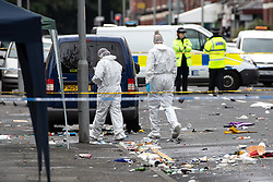 © Licensed to London News Pictures . 12/08/2018. Manchester , UK . Police have closed off Claremont Road in Moss Side after a shooting overnight during the annual Caribbean Carnival celebrations . Ten people are in hospital . Photo credit : Joel Goodman/LNP