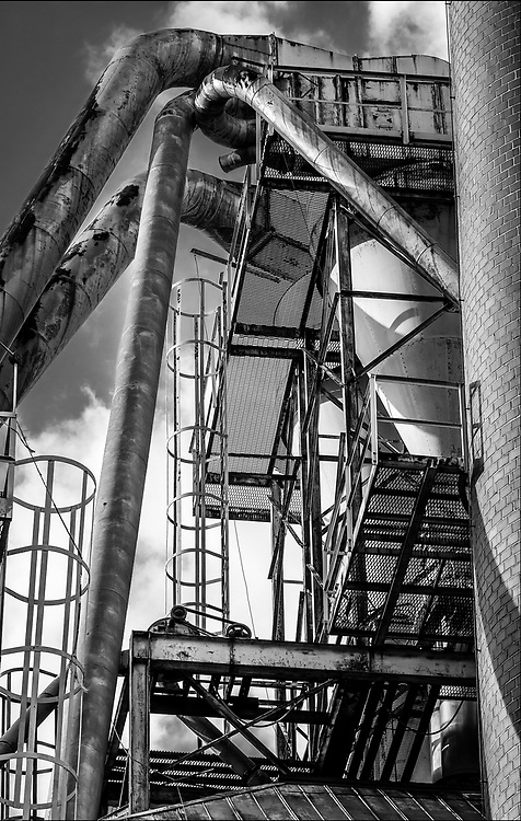 Detail view of smokestack, cyclone, exhaust tubes and scaffolding at the Dixie Furniture Plant in Lexington, NC.