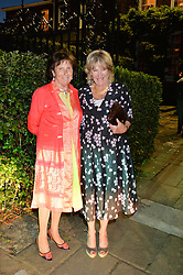 Left to right, LADY AMABEL LINDSAY and ANNABEL ELLIOT attending Annabel Goldsmith's Summer party held at her home in Ham, Surrey on 10th July 2014.
