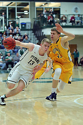 21 February 2017:  Brady Rose cranks it up as he passes the 3 point line defended by Jacob Johnston during an College men's division 3 CCIW basketball game between the Augustana Vikings and the Illinois Wesleyan Titans in Shirk Center, Bloomington IL