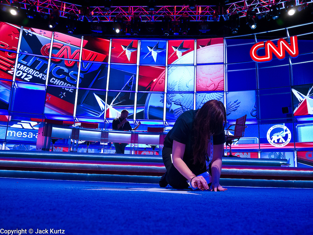 22 FEBRUARY 2012 - MESA, AZ:  Stage workers put the finishing touches on the set for the Arizona Republican Presidential Debate in the Mesa Arts Center. The Mesa Arts Center is the site of the 2012 Arizona Republican Presidential Debate. It's the last debate before the Arizona and Michigan primaries on Feb. 28 and Super Tuesday on March 6.       PHOTO BY JACK KURTZ