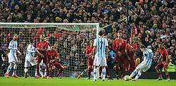 MANCHESTER, ENGLAND - Tuesday, November 18, 2014: Argentina's captain Lionel Messi takes a free-kick against Portugal during the International Friendly match at Old Trafford. (Pic by David Rawcliffe/Propaganda)
