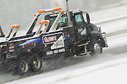 A wrecker drives on interstate 43 in Green Bay, Wisconsin druing a snow strom in March 2011.(Photo by Mike Roemer)