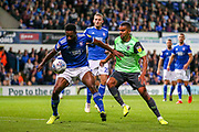 AFC Wimbledon forward Kwesi Appiah (9) tussles with Ipswich Town defender Janoi Donacien (2) during the EFL Sky Bet League 1 match between Ipswich Town and AFC Wimbledon at Portman Road, Ipswich, England on 20 August 2019.