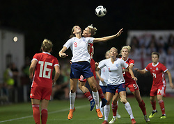 NEWPORT, WALES - Thursday, August 30, 2018: Wales' Jessica Fishlock goes up for a header with England's Jill Scott during the FIFA Women's World Cup 2019 Qualifying Round Group 1 match between Wales and England at Rodney Parade. (Pic by Laura Malkin/Propaganda)