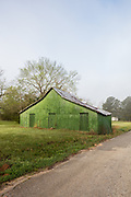 "The Green Barn | Over the course of 30 years, photographer William Christenberry chronicled the slow return to the earth of many ""forgotten"" rural structures during his annual trip home to Alabama. The Green Barn is his most famous."