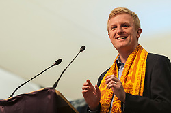 © Licensed to London News Pictures. 05/09/2015. Watford, UK. Oliver Dowden, MP for Hertsmere, gives a speech as Zac Goldsmith, MP for Richmond, and other VIPs visit the biggest Janmashtami festival outside of India at the Bhaktivedanta Manor Hare Krishna Temple in Watford, Hertfordshire.  The event celebrates the birth of Lord Krishna and the festival  includes music, dance, food, dramas and more. Photo credit : Stephen Chung/LNP