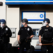 Police officers guard a Chase Bank ATM in Seattle, Washington during a protest by the Occupy Seattle movement on November 9, 2011.